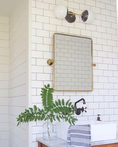 Subway tile & mixed finishes for the win. What a timeless beauty by @britttanyh including our Theo in modern black and brass.