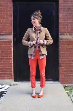 Ref jeans, red gingham shirt layered with a plaid shirt and a camel jacket