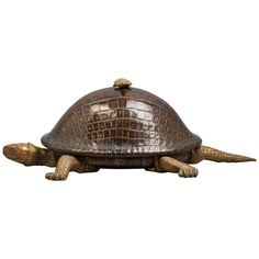 Turtle Inkstand, circa 1875 -- English made of bronze and leather-simulated carapace, the hinged turtle shell lifts to reveal a bronze topped glass inkwell.  Height 5 inches  Width 13.25 inches