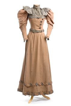 Cotton faille dress, 1890s Beige cotton faille dress, with delightfully puffed sleeves and a smooth but full skirt. It is ornamented with blue cording and tiny steel beading.