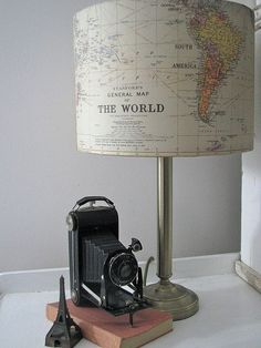 Cavallini gift wrap covered lamp shade -- easy DIY with old maps, wallpaper or wrapping paper.