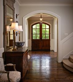 Like: basket weaved wood floors Like: rounded double doors Like: trimmed cased opening