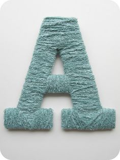 Yarn wrapped letters - I want to try this with Cadel's name for his room... if I like it... we'll do the whole alphabet