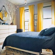light gray walls, robin's egg blue bedding, bright yellow curtains, white dresser. love the colors!