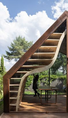 The Barcelona-based practice was commissioned to create a studio in the garden of a local children's book author that could serve as a source of inspiration for her future books. Interior Cladding, Building A Cabin, Cast Iron Stove, New Architecture, Digital Fabrication, Small Buildings, Spanish House, Cladding Panels, Arquitetura