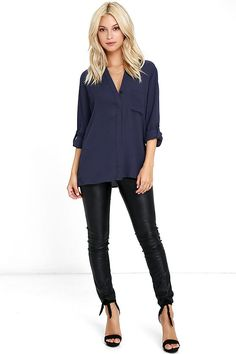 The Oxford Street Navy Blue Button-Up Top is right at home on bustling streets filled with fashion elite! Woven poly shapes a collarless neckline that falls into a relaxed bodice with a patch pocket and partial button placket. Long sleeves (with button cuffs) can be worn down or rolled up thanks to button tabs.