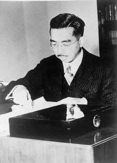 Hirohito Emperor of Japan fixing a seal to his documents. Although held by many Westerners responsible for the war in the Far East, all orders being issued in his name, Hirohito remained in the background during the war and only came to the fore as the defeat of Japan became imminent. He remained on the throne after the war but was obliged by the Allies to renounce his divinity which had hitherto been the basis of his status.