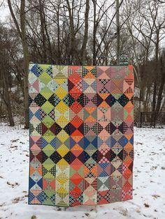 Denyse Schmidt scrappy quarter square triangle quilt