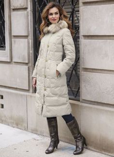 Quilted Coat with Faux Fur Trimmed Hood from Monroe and Main. Be ready for winter's blasts with this long coat, made extra toasty by quilted body with down blend fill, faux fur-lined hood and storm placket.