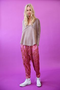 Casablanca Harem Pant || Harem style silky printed pants featuring pleat detailing and hip pockets. Smocked elastic waistband in back for an easy fit.