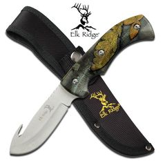 Elk Ridge Fall Camo Gut Hook Hunting Knife. Elk Ridge Fall Camo Gut Hook Hunting KnifeElk Ridge Fall Camo Gut Hook Hunting knifeHeavy duty FULL TANGGut Hook Hunting KnifeOverall Length: 9 Blade Length: 4 Blade Material: 440 Stainless Steel Handles Fall Camo molded handles,camo pattern will vary from photo. Sheath: Custom Balastic Nylon with stitched logo 80531906929