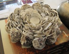 oyster-candle-holder-votive-amazing-layered (maybe inside a container so you don't see the outside of the oyster shells)