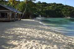 Honeymoon Beach, Water Island   Here, and Magen's Bay have the best Pain Killer's. And good snorkeling.
