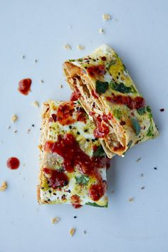 Jianbing - A savory Chinese crepe. The soft mung bean wrapper, typically layered with eggs, scallions, bean paste, and a crispy wonton cracker, is a popular breakfast in Beijing.