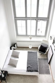 So simple - bedroom in white, grey & black - love the double layered windows.