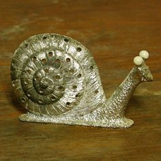 Vintage snail earring holder - stand - silver - metal - slug. $8.50, via Etsy.