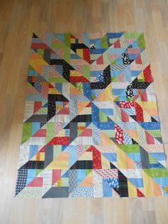 Jelly roll strips to make HST blocks  Baby quilt