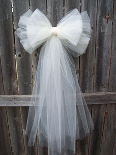 wedding pew bows tulle pew bow tulle wedding formal aisle decor by onefunday 13 00 weddingThis Tulle Pew Bow OVER 20 COLORS Church Pew Decor Tulle Pew is just one of the custom, handmade pieces you'll find in our decorations shops.Tulle Pew arc plus de 20 Church Pew Wedding Decorations, Tulle Decorations, Wedding Pews, Wedding Chairs, Bridal Shower Decorations, Diy Wedding, Wedding Flowers, Wedding Church, Trendy Wedding