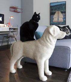 dog shaped scratching post. yes.