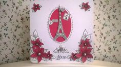 A card I made using a HoneyDoo Crafts stamp for the flowers then cut them out and shaped them. I used a Dreamers stamp of the Eiffel Tower and an Apple Blossom Die for the oval frame. X