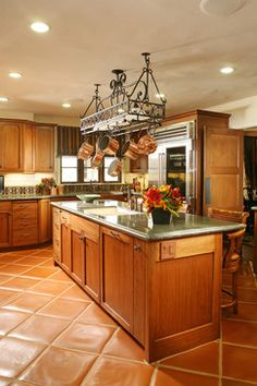 warm up your kitchen floors with wide plank wooden floors or preferably solid, rustic terracotta tiles or even better still, traditional Saltillo tiles. These pinkish-orange tiles are slightly irregular, have great texture and come in a wide variety of shapes and sizes. Moreover, you can seal or glaze them with a high quality sealer which gives the patina greater depth and so that they wear well over time and have minimal maintenance.