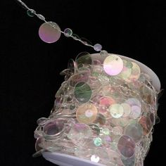 99 feet of Acrylic Iridescent Clear Champagne Bubble Beads on a spool. Can be cut to any desired length. Beads are individually fused with the string so the strand will remain intact when sections are