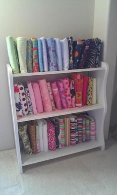 Cheap Fabric Storage. This I could do! What are they wrapped around?