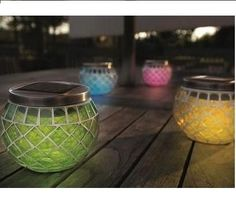 Solar Lanterns | Solar Powered Multi Coloured Mosaic Lanterns Comes as a 4 pack emitting green, yellow, blue and pink lights. Ideal for outdoor tables, patios, decks and balconies.