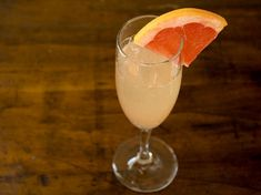 Grapefruit and Ginger Sparkler 1 ounce fresh squeezed grapefruit juice 1/2 ounce Domaine de Canton ginger liqueur 3 to 4 ounces Prosecco or other sparkling wine Grapefruit wedge to garnish