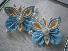 2 handmade KANZASHI hair clips.Gorgeous handmade hair clips with half pearl embellishments.The flowers, made of grosgrain ribbon, measure apprx. 4cm(1-1/2) by 4cm(1-1/2).    Mounted on a silver coloured alligator hair clip- 3.2cm (1-1/4)long.    My hair accessories are all handmade and designed exclusively by me in my studio in Essex(smoke/pet free).    I always use the highest quality ribbon and materials.   All hair accessories made of ribbon and satin fabric are heat sealed to prevent…