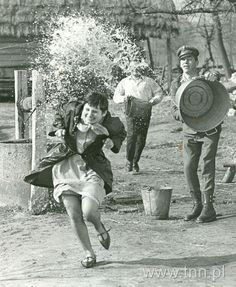 POLISH EASTER: How adorable is this old photo I found? It's for Lany Poniedzialek/Smingus Dyngus which means wet Monday... All the boys in town throw buckets of water on girls these days they love to use water guns too! The saying goes the more drenched you get the more chance you have of getting married by sammyandbellaofficial