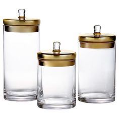 Stow dry goods in the pantry or cotton balls in the master bath with this set of 3 glass canisters, featuring gold-hued lids for a touch of shimmer....