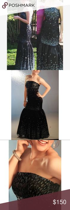 Elegant, Mermaid Prom Dress by Jessica Mcclintock Elegant black mermaid prom dress with blue and silver glitter teardrops.  -The best part is the back, which laces across with a beautiful ribbon. -Zipper (hidden from view) on left side for easy on & off).  -Tulle skirt to help accentuate the mermaid, but not a lot of it making it a functional dress to dance in.  -Perfect fit, like new condition.  -Size 7/8 -Length aprox 49 in -Width aprox 16.75 in -100% polyester   Made in USA Jessica…