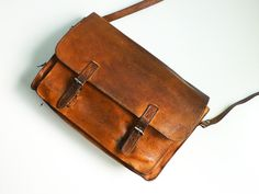 Distressed 70s vintage briefcase laptop bag brown leather school. €45,00, via Etsy.