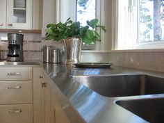 Stainless Steel worktop with trad wooden units. The Worktop Workshop in Meath