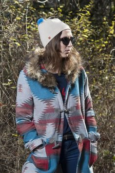 """The beige Nippy beanie with its sky blue pom pom is the perfect hat to wear between seasons. This beanie is designed for the """"it's a bit nippy this morning"""" we Rain Jacket, Bomber Jacket, Knitwear, Windbreaker, Beanies, How To Wear, Jackets, Blue, Fashion"""