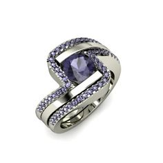 The Ocean ring with an iolite center stone and two matching bands on either side, also with Iolites!