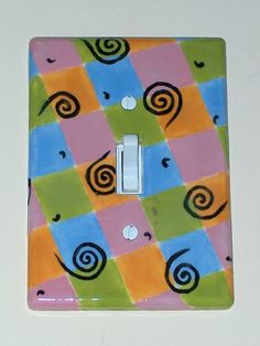 Hand painted light switch plate pottery.