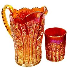 these are the carnival glass containers my gm has. she has like a dozen of the cups, maybe one or two of the pitchers, and some bowls. this photo is a little bright :P Glass Jug, Fenton Glass, Milk Glass, Cranberry Glass, Glass Company, Indiana Glass, Chocolate Pots, Glass Dishes, Glass Containers