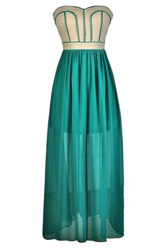 FINAL SALE. Dramatic and bold describes this contrasting strapless chiffon maxi dress with fabric piping. The Along The Lines Strapless Chiffon Maxi Dress has a strapless sweetheart neckline and lightly padded bust. The top part is made of a substantial fabric with some stretch to it.  Contrasting fabric piping decorates the bust, creating an unexpected look. The attached skirt is made of semi-sheer chiffon and has a full length maxi cut.  It is lined to the mid-thigh. The back of this…
