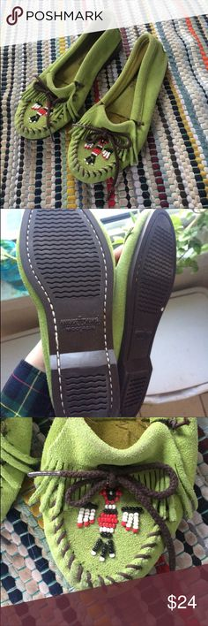 Minnetonka moccasins Reposh! Super cute, green beaded moccasins. My foot has just gotten bigger so they are a little snug. So sad because I love the color. Minnetonka Shoes Moccasins