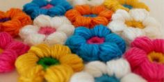 This puff stitch flower six petal puffy crochet stitch can be used to make an item all on its own such as a super-cuddly blanket