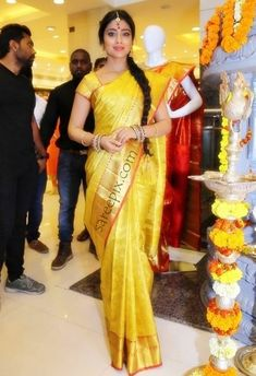 Beautiful heroine Shriya in silk saree photos at VRK silks launch in Warangal. The 33-years old ageless beauty was gorgeous in bridal silk saree with match