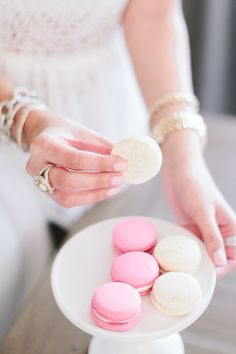 Pretty pink and white macarons: http://www.stylemepretty.com/living/2016/04/25/peek-inside-a-bloggers-glamorous-home-re-vamp/ | Photography: Angela Cox - http://www.angelacoxphotography.com/