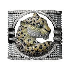 Panthère de Cartier High Jewelry bracelet Platinum, cultured pearls, yellow diamonds, brown diamonds, orange diamonds, onyx, tsavorite garnet eyes, brilliants.