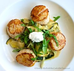 Get rid of the winter blahs with this colorful, light dish!  Zucchini ribbons, basil, goat cheese, and sea scallops - quick and easy.