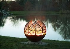 This very balanced, aesthetically pleasing design is the Autumn Sunset Leaf Fire Pit Sphere by Melissa Crisp. This unique artisan fire bowl is 37 inches in diameter and can be a great patio centerpiece even without the fire. Fire Pit Sphere, Metal Fire Pit, Cool Fire Pits, Diy Fire Pit, Fire Pit Backyard, Fire Pit Art, Garden Fire Pit, Fire Pit Gallery, Custom Fire Pit