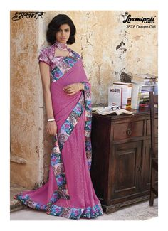 Stylish pale violet Red Georgette Saree with Digital Geographic and Floral and Abstract Printed Lace which enhances overall appeal of this saree. It comes with Digital Printed mint green and magenta coloured Pashmina Blouse.