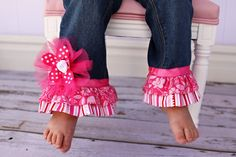 Your little girl will look precious in this one of a kind boutique set. The brand new jeans have 2 layers of ruffles with a ribbon embellishment. A flower pin made with ribbon, tulle and a rosette accent adorns the right leg and can be removed for easy washing. A matching ribbon belt fits through the loops and ties in a bow in front.