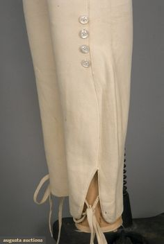GENT'S WHITE LEATHER PANTS, ENGLAND, 1800-1825  Heavy white deerskin with four button broad fall front, legs tight and shaped to ankles with vent and tape ties, four shell buttons at knees for boot straps, (minor stains) excellent.